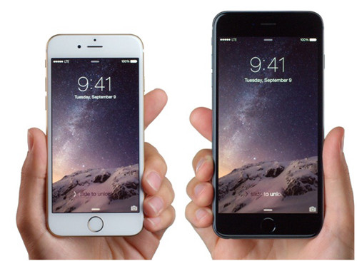 iРhone 6 plus и iPhone 6 держат в руках